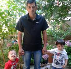 Aylan, his brother Galip, and their Dad, before yesterday.